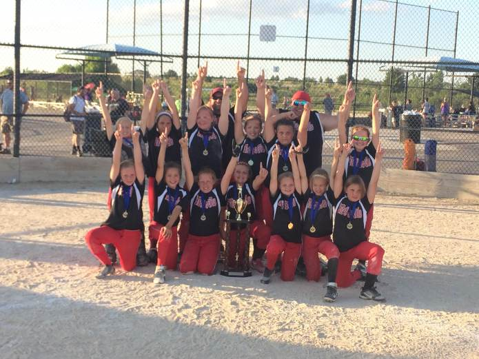 The 10u team celebrates their victory in the Heartland C World Series this weekend.