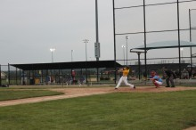 A's player drive the ball to the outfield on Wednesday night against the KC Monarchs.