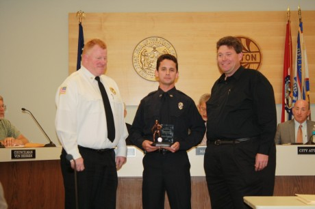 Belton Firefighter Chris Godenaz accepts his award from the Belton City Council on June 23. Photo by Jennifer Reed