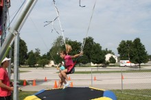 Jumping on a trampoline, a Kanakuk Camper demonstrates her acrobatic ability during the weeklong summer camp. Kanakuk Kampout! visited the First Baptist Church of Raymore last week and hosted nearly 100 kids.