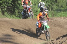 Racers take practice laps around the track Tuesday night in preparation for the County Fair Motocross Races.