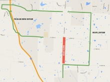The green lines indicate the detour route around the closed portion of the road, indicated in red.